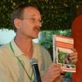 Ken Giller holding handbook
