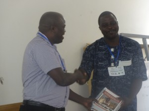 OFRA training Nigeria May 2017 Harrison give book to The Dean Faculty of Agriculture University of Abuja, Prof Adeniji